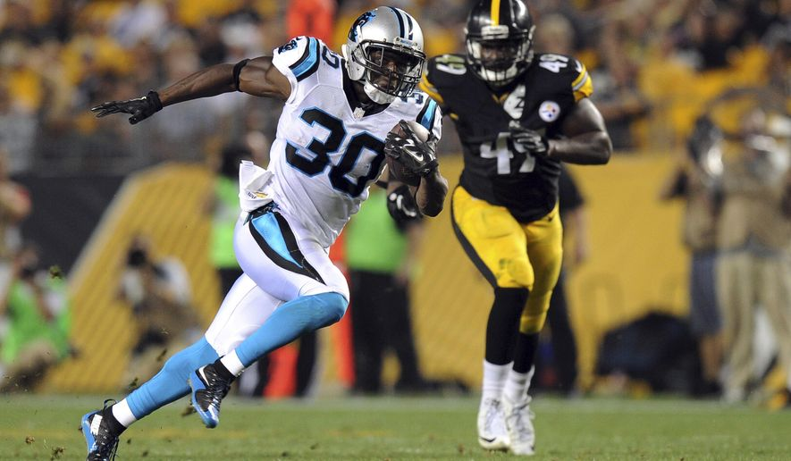 Carolina Panthers running back Jordan Todman (30) dashes past Pittsburgh Steelers linebacker Shayon Green (49) on his way to a touchdown during the second quarter of an NFL preseason football game, Thursday, Sept. 3, 2015, in Pittsburgh. (AP Photo/Don Wright)