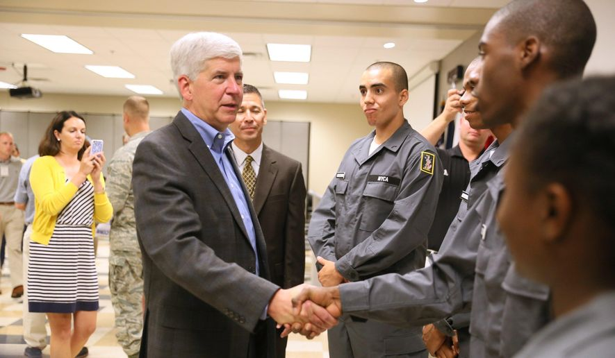Michigan Gov. Rick Snyder greets members of the Michigan Youth Challenge Academy during the first-ever Michigan Congressional defense tour of Michigan's military installations at the Battle Creek Air National Guard Base in Battle Creek, Mich., Thursday, Sept. 3, 2015. (Mark Bugnaski /Kalamazoo Gazette-MLive Media Group via AP) ALL LOCAL TELEVISION OUT; LOCAL TELEVISION INTERNET OUT; MANDATORY CREDIT **FILE**