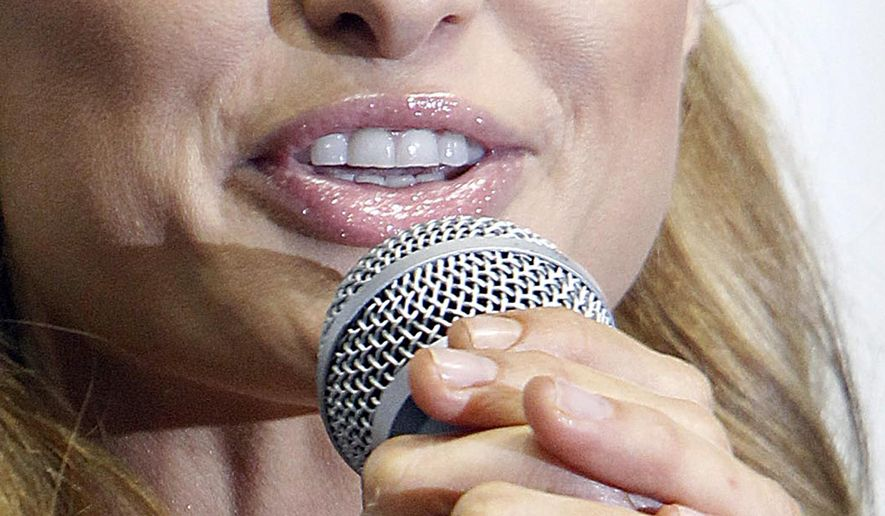 FILE--In this Aug. 28, 2015 file photo Paris Hilton wears her diamond-studded ring as she speaks to the press during a fashion show in Lodz, Poland, Friday, Aug. 28, 2015.The 34-year-old socialite lost the enormous ring on a shuttle bus on her way to the Lodz airport and two days later a fireman who works at the airport found it on the floor of the bus. (AP Photo/Czarek Sokolowski, file)