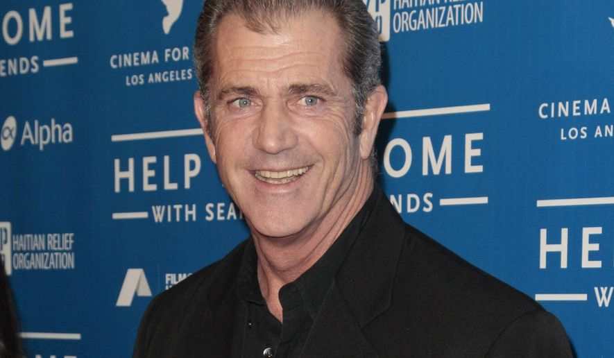 FILE - In this Jan. 14, 2012 file photo, Mel Gibson arrives at the Cinema for Peace benefit for the J/P Haitian Relief Organization in Beverly Hills, Calif. Police said Thursday, Sept. 3, 2015 in a statement they do not intent to charge Oscar-winning director Gibson over an allegation that he shoved and abused a newspaper photographer who snapped pictures of him and his new girlfriend in Sydney last month. The Daily Telegraph staff photographer Kristi Miller complained to police about the Aug. 23 altercation with Gibson after he and girlfriend Rosalind Ross were photographed leaving a movie in inner-suburban Paddington. (AP Photo/Jason Redmond, File)