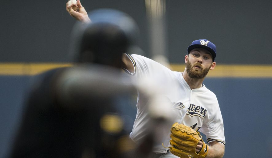 Milwaukee Brewers' Taylor Jungmann pitches to a Pittsburgh Pirates batter during the first inning of a baseball game, Thursday, Sept. 3, 2015, in Milwaukee. (AP Photo/Tom Lynn)