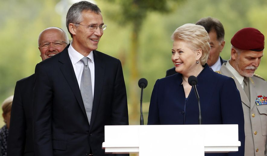 NATO Secretary General Jens Stoltenberg, left, and Lithuania's President Dalia Grybauskaite smile during the ceremony inaugurating the headquarters of the NATO Force Integration Unit in Vilnius, Lithuania, Thursday, Sept. 3, 2015. NATO Force Integration Units are small command and control headquarters whose key mission is to facilitate the rapid deployment of the NATO Very High Readiness Joint Task Force  and additional rapid response elements into the region if needed.  (AP Photo/Mindaugas Kulbis)
