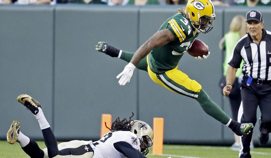 Green Bay Packers' Rajion Neal runs back a kickoff during the first half of an NFL preseason football game against the New Orleans Saints, Thursday, Sept. 3, 2015, in Green Bay, Wis. (AP Photo/Jeffrey Phelps)