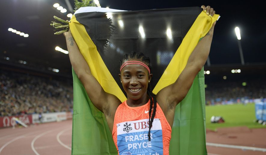 Shelly-Ann Fraser-Pryce from Jamaica reacts after winning the women's 100m race during the IAAF Diamond League athletics meeting in the Letzigrund stadium in Zurich, Switzerland, Thursday, Sept.3, 2015. ( Anthony Anex/Keystone via AP)