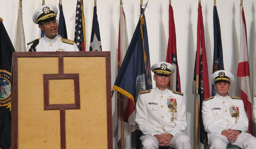 U.S. Strategic Command commander Adm. Cecil Haney, left, speaks at a change of command ceremony in Pearl Harbor, Hawaii on Thursday, Sept. 3, 2015 as Rear Adm. Frederick Roegge, center, and Rear Adm. Phillip Sawyer, right, listen. Roegge took over from Sawyer as the commander of the U.S. Pacific Fleet's submarine force during the ceremony. (AP Photo/Audrey McAvoy)