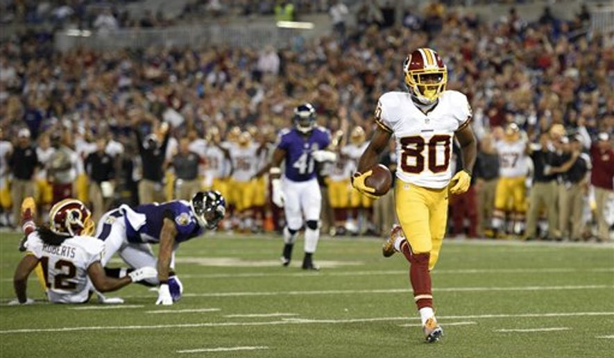 Washington Redskins wide receiver Jamison Crowder (80) jogs into the end zone for a toughdown in the first half of a preseason NFL football game against the Baltimore Ravens, Saturday, Aug. 29, 2015, in Baltimore. (AP Photo/Nick Wass)