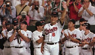 Baltimore Orioles Cal Ripken waves to the crowd in the middle of the fifth inning of their game against the California Angels Wednesday, Sept. 6, 1995 in Baltimore's Camden Yards. Ripken broke Lou Gehrig's record of 2,130 consecutive games Wednesday night. (AP Photo/Denis Paquin)