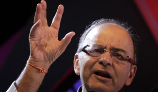 """The Chinese 'normal' has now changed. It is no longer the 9 percent, 10 percent, 11 percent growth rate,"" Indian Finance Minister Arun Jaitley said. ""So the world needs other engines to carry the growth process, and in a slowdown environment in the world, an economy which can grow at 8 to 9 percent like India certainly has viable shoulders to provide the support to the global economy."" (Associated Press)"