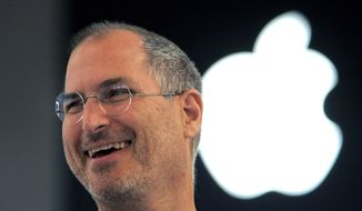 In this Sept. 20, 2005 file photo, Apple co-founder Steve Jobs smiles after a press conference as he opens the Apple Expo in Paris. (AP Photo/Christophe Ena, File)