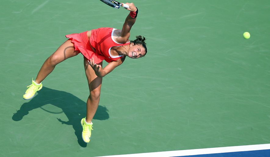 Sara Errani, of Italy, serves to Jelena Ostapenko, of Latvia, during the second round of the U.S. Open tennis tournament, Thursday, Sept. 3, 2015, in New York. (AP Photo/Adam Hunger)