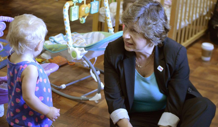 American Federation of Teachers national President Randi Weingarten, right, speaks to 15-month old Peyton Duncan, left, at Los Ninos Montessori School in Los Ranchos de Albuquerque, N.M, Thursday, Sept. 3, 2015. Weingarten and New Mexico supporters unveiled a plan aimed at expanding early childhood education in New Mexico amid a stalemate over funding. (AP Photo/Russell Contreras)