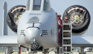 A-10 Warthog aircraft mechanic Bill Yurgen removes protective covers from the aircraft before a congressional delegation begins their tour of major military sites in the state, Wednesday, Sept. 2, 2015. The congressional members, all from Michigan, toured Selfridge Air National Guard Base in Harrison Twp., as their first stop on a two-day tour of major Michigan military installations.  (Todd McInturf/The Detroit News via AP) ** FILE **