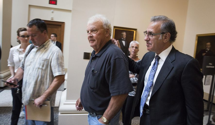 Steven Meshbesher, right, defense attorney for Byron Smith, walks with Bill Anderson, a neighbor and friend of Smith, after an appeal hearing before the Minnesota Supreme Court in St. Paul, Minn., on Thursday, Sept. 3, 2015. Defense attorneys for Smith, who was convicted of killing two teenage intruders in his Little Falls home, filed an appeal with the Minnesota Supreme Court arguing that Smith's trial was riddled with mistakes from the original indictment, through the trial and right up to the prosecutor's closing arguments.  (Leila Navidi/Star Tribune via AP, Pool)
