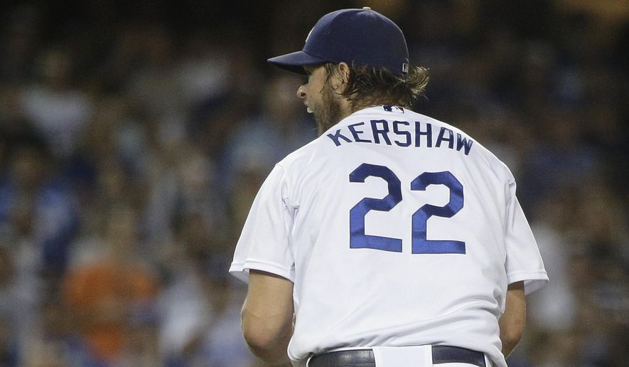 Los Angeles Dodgers starting pitcher Clayton Kershaw reacts after striking out San Francisco Giants' Andrew Susac during the eighth inning of a baseball game, Wednesday, Sept. 2, 2015, in Los Angeles. (AP Photo/Jae C. Hong)
