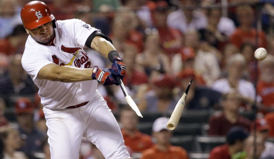 St. Louis Cardinals' Jhonny Peralta breaks his bat while hitting a single during the fifth inning of a baseball game against the Washington Nationals on Wednesday, Sept. 2, 2015, in St. Louis. (AP Photo/Jeff Roberson)