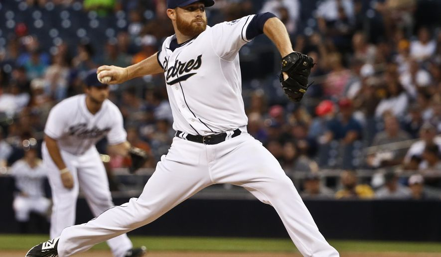 San Diego Padres starting pitcher Ian Kennedy works against the Texas Rangers during the first inning of a baseball game Wednesday, Sept. 2, 2015, in San Diego. (AP Photo/Lenny Ignelzi)