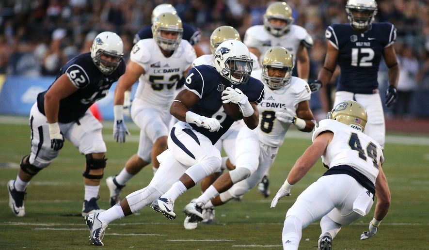 Nevada's Don Jackson (6) runs up the middle against UC Davis during the first half of an NCAA college football game in Reno, Nev., on Thursday, Sept. 3, 2015. (AP Photo/Cathleen Allison)
