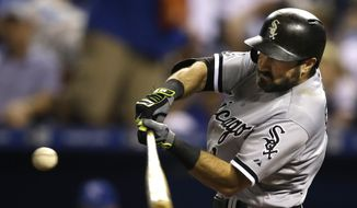 Chicago White Sox' Adam Eaton hits a three-run home run during the eighth inning of a baseball game against the Kansas City Royals at Kauffman Stadium in Kansas City, Mo., Friday, Sept. 4, 2015. (AP Photo/Orlin Wagner)