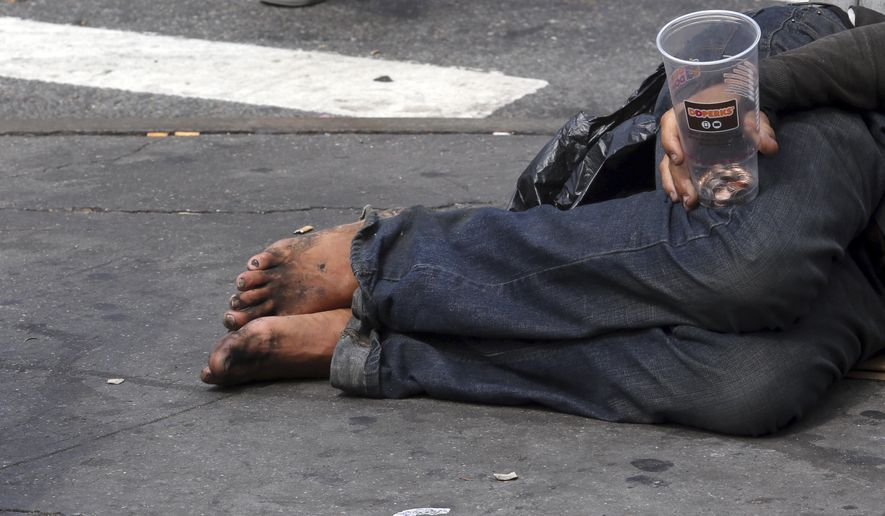 A homeless man asks for money on 14th Street, Friday, Sept. 4, 2015, in New York. (AP Photo/Mary Altaffer)