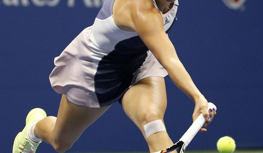 Caroline Wozniacki, of Denmark, chases a shot by Petra Cetkovska, of the Czech Republic, during the second round of the U.S. Open tennis tournament in New York, Thursday, Sept. 3, 2015. (AP Photo/Julio Cortez)