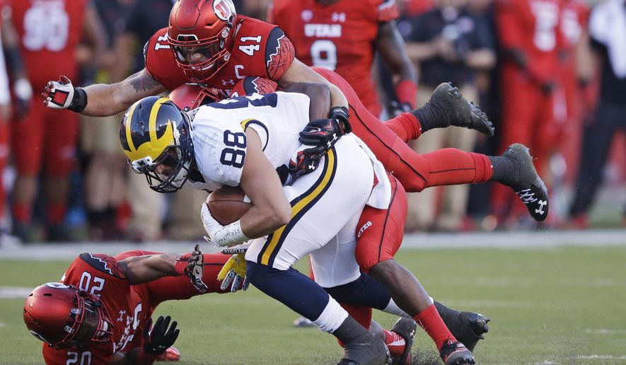 Utah linebacker Jared Norris (41) tackles Michigan tight end Jake Butt (88) in the first quarter during an NCAA college football game, Thursday, Sept. 3, 2015, in Salt Lake City. (AP Photo/Rick Bowmer)