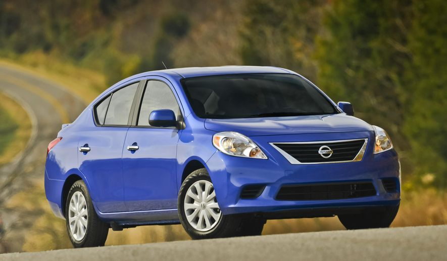 This photo provided by Nissan shows the 2013 Nissan Versa. Nissan is recalling nearly 300,000 of its Versa and Versa Note vehicles to adjust a console panel that could catch the driver's shoe and slow braking speed. The recall involves Versa sedans made between June 9, 2011, and March 11, 2015, and Versa Note vehicles made between April 23, 2013 and March 11, 2015. (Nissan via AP)