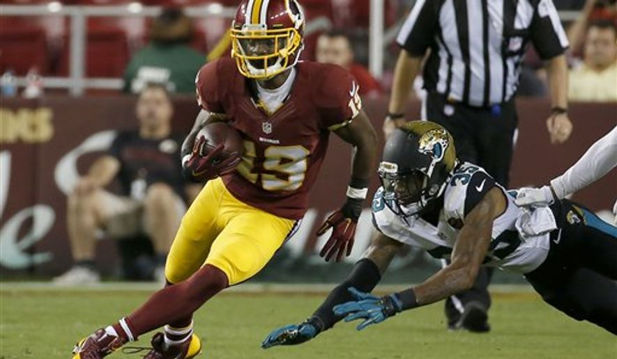Washington Redskins wide receiver Rashad Ross (19) carries the ball during the first half of an NFL preseason football game against the Jacksonville Jaguars in Landover, Md., Thursday, Sept. 3, 2015. (AP Photo/Alex Brandon)