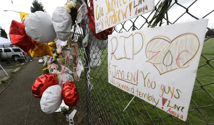 In this Oct. 27, 2014, file photo, a hand-written sign is attached to a fence at a growing memorial at Marysville Pilchuck High School in Marysville, Wash. The sign makes reference to Jaylen Fryberg, a freshman at the school who fatally shot four friends in the school cafeteria on Oct. 24, 2014, before killing himself. (AP Photo/Ted S. Warren, file)