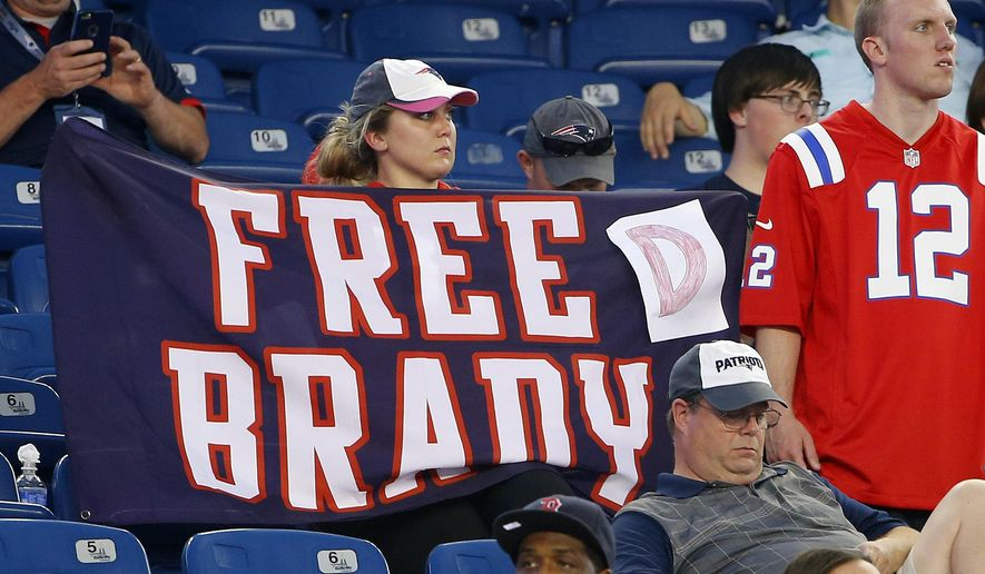 A New England Patriots fan holds a sign referring to Patriots quarterback Tom Brady before an NFL preseason football game between the Patriots and the New York Giants Thursday, Sept. 3, 2015, in Foxborough, Mass. Federal Judge Richard M. Berman overturned NFL Commissioner Roger Goodell's four-game suspension of Brady Thursday morning. The league said it will appeal the ruling. (AP Photo/Winslow Townson)