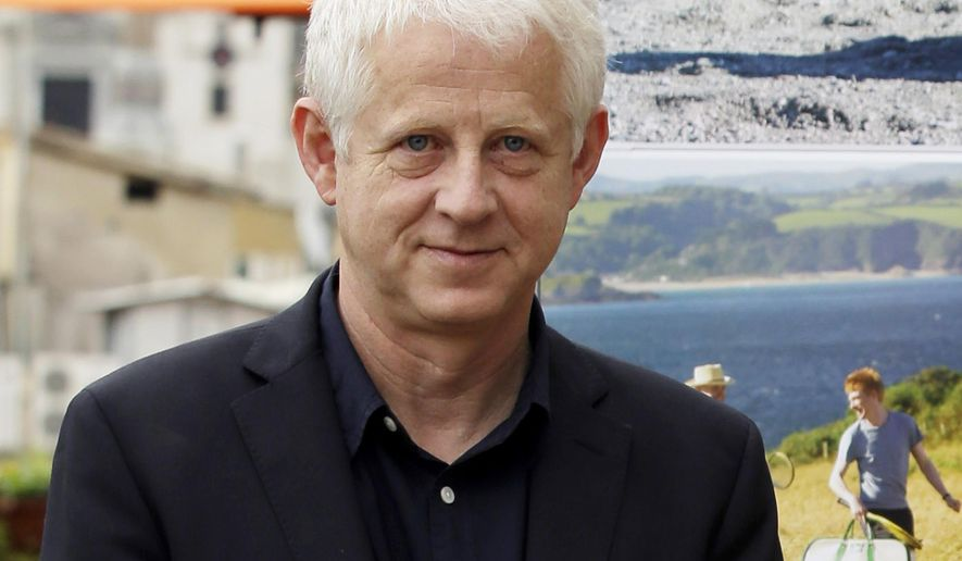 "FILE - In this Oct. 21, 2013 file photo, British director Richard Curtis poses for the photographers as he present his latest movie ""About Time"" , in Rome.  The United Nations is launching a global campaign with a media blitz and an array of stars from Beyonce to Usain Bolt to spread news to everyone in the world about its new goals to eradicate poverty, fight inequality and combat climate change. Curtis, who is leading the campaign, told a news conference Thursday, Sept. 8, 2015, that he wants to make these new goals ""much more famous and much more well-known"" than the eight U.N. Millennium Development Goals adopted at a summit in 2000 which they will succeed. (AP Photo/Gregorio Borgia, FIle)"