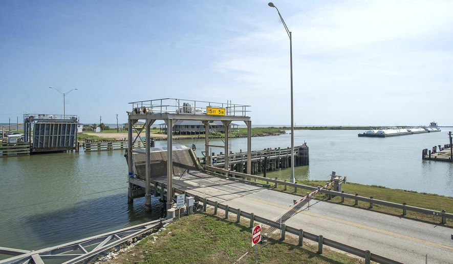 FOR RELEASE MONDAY, SEPTEMBER 7, 2015, AT 12:01 A.M. CDT.-   This photo taken Aug. 27, 2015, shows traffic being stopped along FM 457 in Sargent, Texas, with the swing bridge open for a barge.  (Sarah Rencurrel /The Brazosport Facts via AP)