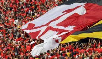 Fans pull a giant Maryland state flag across the stands in the first half of an NCAA college football game between Maryland and Richmond, Saturday, Sept. 5, 2015, in College Park, Md. (AP Photo/Patrick Semansky)