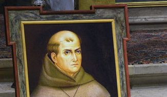 In this May 6, 2015, file photo, a painting of the Rev. Junipero Serra is seen above his grave inside the basilica at the Carmel Mission in Carmel, Calif. (David Royal/The Monterey County Herald via AP, File)