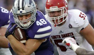 Kansas State fullback Glenn Gronkowski (48) breaks away from South Dakota defensive lineman Sean Bredl (55) during the first half of an NCAA college football game in Manhattan, Kan., Saturday, Sept. 5, 2015. (AP Photo/Orlin Wagner)
