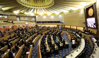 Thailand's legislature, known as the National Reform Council, stands after they votee 135 against vs. 105 in favor with seven abstentions on the new draft constitution Sunday, Sept. 6, 2015, in Bangkok, Thailand. Thailand's military-backed legislature on Sunday rejected an unpopular draft of a new constitution, delaying a return to democracy following a coup last year. (AP Photo/Wason Wanichakorn)