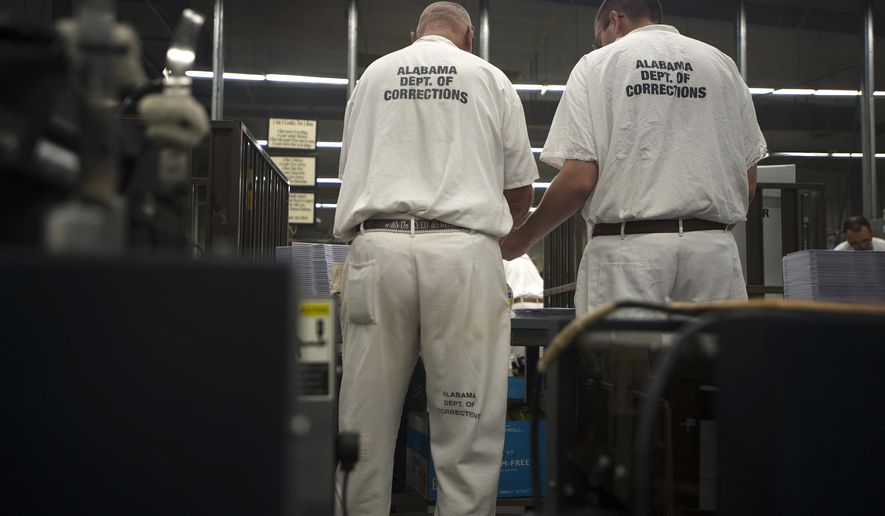 Inmates work in the Kilby Corrections Facility printing area in Montgomery, Ala., on Friday, Sept. 4, 2015. The facility currently houses three times the number of inmates it was originally designed to hold. Kilby was built for 440 inmates and in June housed 1,279 inmates, according to prison statistics. (Albert Cesare/The Montgomery Advertiser via AP)  NO SALES; MANDATORY CREDIT