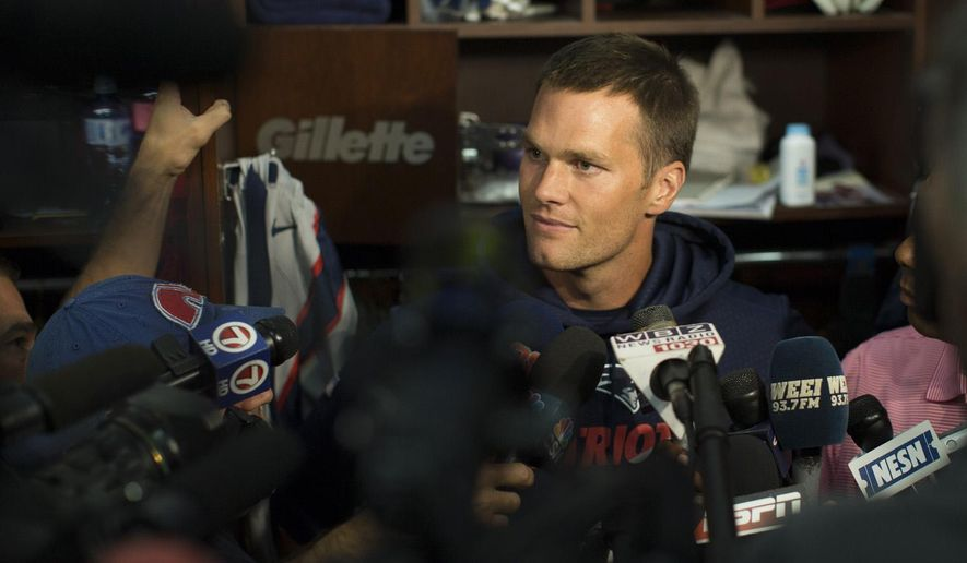 New England Patriots quarterback Tom Brady speaks to members of the media in the locker rook at Gillette Stadium prior to the team's practice in Foxborough, Mass, Sunday, Sept. 6, 2015. (Keith Bedford/The Boston Globe via AP) MANDATORY CREDIT NO SALES, MAGS OUT, INTERNET OUT, ARCHIVE OUT BOSTON HERALD OUT, QUINCY OUT