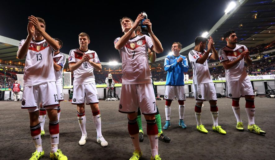 Germany's captain Bastian Schweinsteiger, center, celebrates with his teammates after the victory over Scotland at the end of their Euro 2016 Group D qualifying soccer match at Hampden Park, Glasgow, Scotland, Monday Sept. 7, 2015. (AP Photo/Scott Heppell)