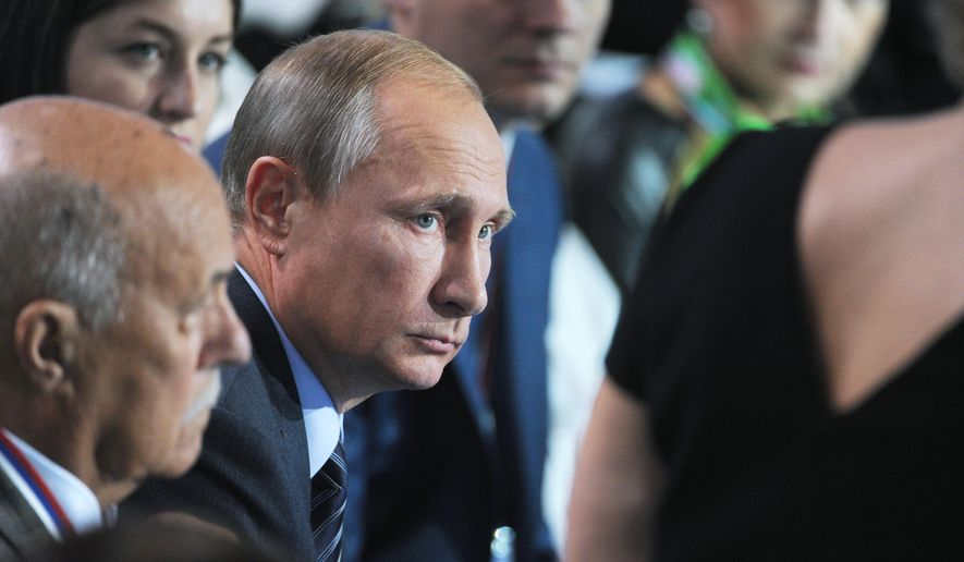 Russian President Vladimir Putin (center) listens to a question during a meeting with his supporters in Moscow on Sept. 7, 2015. Putin took part in a discussion on Monday of a health care reform with his supporters who form All-Russian People's Front. (Mikhail Klimentyev/RIA-Novosti, Kremlin Pool Photo via AP) **FILE**