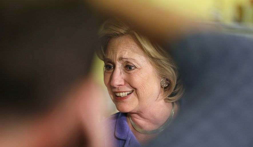Democratic presidential candidate Hillary Rodham Clinton greets supporters during a campaign stop at Uncle Nancy's Coffee House, Sunday, Sept. 6, 2015, in Newton, Iowa. (AP Photo/Charlie Neibergall)