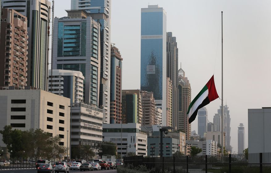 In this photo taken Sunday, Sept. 6, 2015, the flag of the United Arab Emirates is flown at half-staff in honor of Emirati soldiers killed in Friday's attack by Shiite rebels in Yemen, as vehicles pass it by in Dubai. Radio stations across the UAE have replaced their usual upbeat fare with Koranic recitations and classical music to mark three days of mourning commemorating the war dead, an honor typically reserved for the country's top leaders. (AP Photo/Kamran Jebreili)