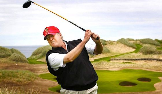 Then-GOP presidential hopeful Donald Trump, who says golf enhances politics, plays a round in Scotland in this September 2015 file photo. (Associated Press) ** FILE **