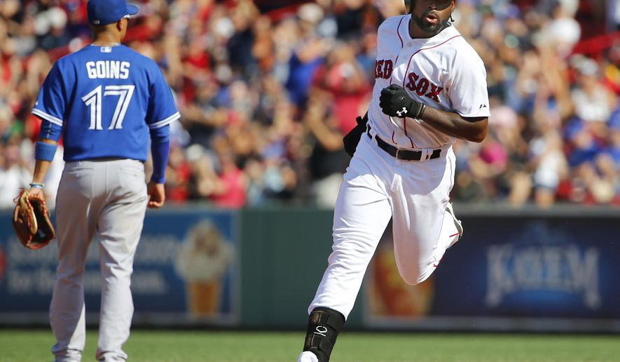 Boston Red Sox's Jackie Bradley Jr. rounds the bases after his two-run home run as Toronto Blue Jays second baseman Ryan Goins (17) walks away during the sixth inning of a baseball game at Fenway Park in Boston Monday, Sept. 7, 2015. (AP Photo/Winslow Townson)