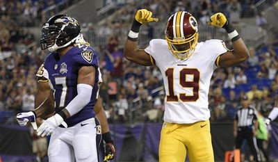 Washington Redskins wide receiver Rashad Ross (19) celebrates his touchdown in front of Baltimore Ravens cornerback Asa Jackson in the second half of a preseason NFL football game, Saturday, Aug. 29, 2015, in Baltimore. (AP Photo/Nick Wass)