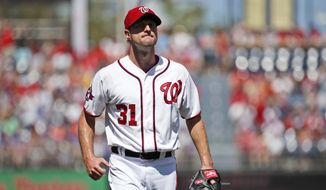 Washington Nationals starting pitcher Max Scherzer reacts after pitching the first inning of a baseball game against the New York Mets at Nationals Park, Monday, Sept. 7, 2015, in Washington. (AP Photo/Alex Brandon)