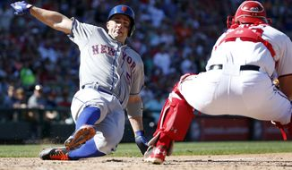 New York Mets' David Wright, left, scores as Washington Nationals catcher Wilson Ramos, right, cannot make the tag in time during the seventh inning of a baseball game at Nationals Park, Monday, Sept. 7, 2015, in Washington. Wright scored on a double by Yoenis Cespedes. The Mets won 8-5. (AP Photo/Alex Brandon)