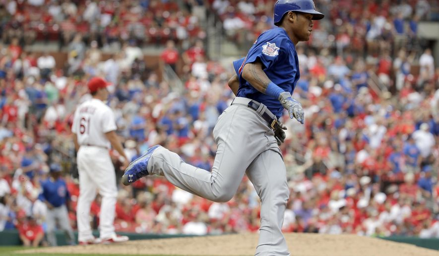 Chicago Cubs' Addison Russell, right, rounds the bases after hitting a three-run home run off St. Louis Cardinals relief pitcher Seth Maness, left, during the third inning of a baseball game Monday, Sept. 7, 2015, in St. Louis. (AP Photo/Jeff Roberson)