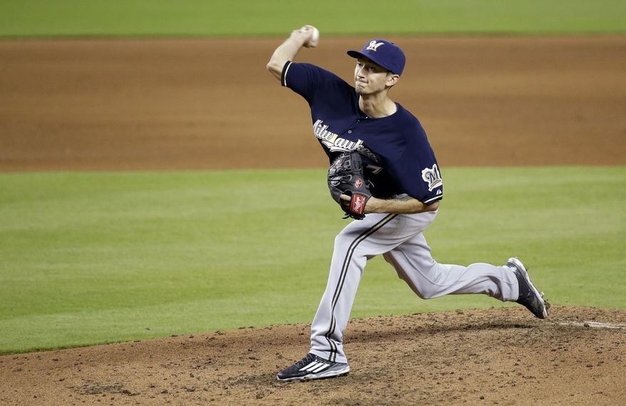Milwaukee Brewers' Zach Davies delivers a pitch during the fifth inning of a baseball game against the Miami Marlins, Monday, Sept. 7, 2015, in Miami. (AP Photo/Wilfredo Lee)