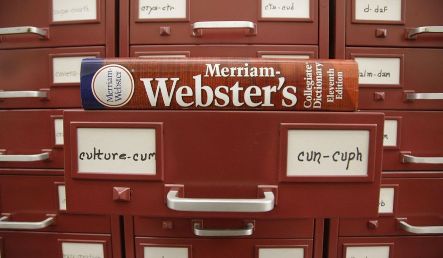 """In this Tuesday, Dec. 9, 2014 photo, a Merriam-Webster dictionary sits atop their citation files for the 2014 word of the year, """"culture,"""" at the dictionary publisher's offices in Springfield, Mass. Citation files are notations of a word used in context over time. Merriam-Webster based its pick and nine runners-up on significant increases in lookups this year over last at its homepage, Merriam-Webster.com. (AP Photo/Stephan Savoia)"""