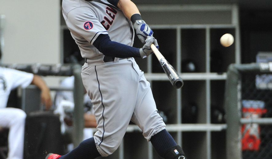 Cleveland Indians' Ryan Raburn hits a home run against the Chicago White Sox during the sixth inning of a baseball game, Monday, Sept. 7, 2015 in Chicago.  (AP Photo/David Banks)
